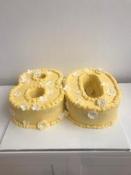 '80' Buttercream cake decorated with fondant flowers