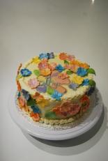 Multi coloured flowered cake