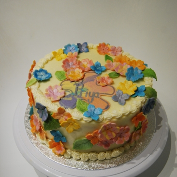 Multi coloured flowered cake