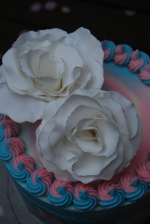 White fondant roses edged with silver